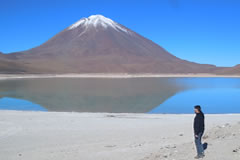 The Licancabur volcano is rfelected in the Green Lagoon.