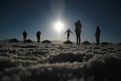 Watch the sun rise inside the Uyuni salt flat.