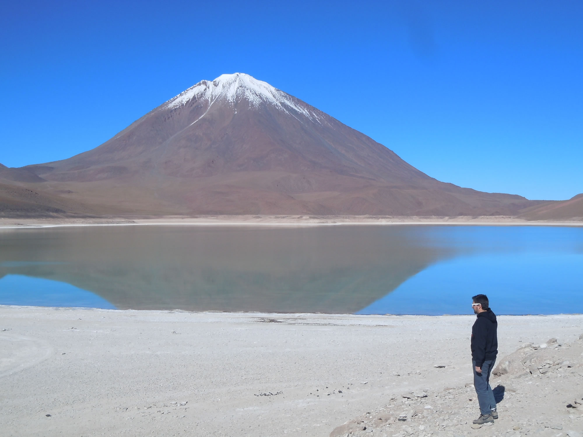 The Licancabur volcano is rfelected in the Green Lagoon